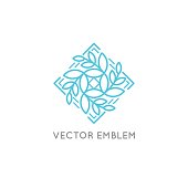 Vector logo design template and emblem made with leaves and flowers -  beauty and spa - badge for yoga classes, holistic centers, natural cosmetics - meditation and health concept