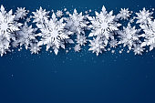 Vector Merry Christmas and Happy New Year greeting card design with white layered paper cut snowflakes on dark blue background. Seasonal Christmas and New Year holidays paper art banner, poster