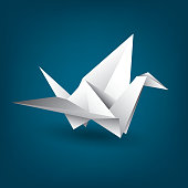 White paper crane on a blue background, origami, Chinese art, paper figurine