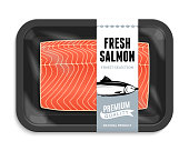 Vector salmon packaging illustration. Black foam tray with plastic film mockup. Modern style fish label.