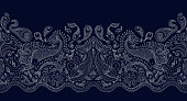 Vector seamless pattern. Fantasy mermaid, octopus, fish, sea animals silver contour thin line drawing with ornaments on a dark blue background. Embroidery border, wallpaper, textile print, wrapping pa