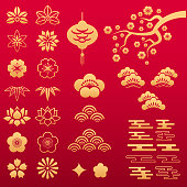 Vector set of asian gold floral patterns and ornaments with sakura, lotus, peony and plum flowers, bamboo leafs and lantern sign on red background