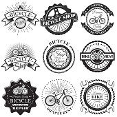 Vector set of bicycle repair shop labels and design elements in vintage black and white style. Bike , symbols, emblems.
