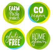 Set of four healthy food labels with lettering. Vegan food stickers.