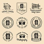 Vector set of old cameras icons. Vintage photo studio, salon signs, labels or badges