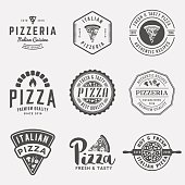 vector set of pizzeria labels and badges. vector illustration