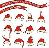 Various doodles Santa hats isolated on white background.