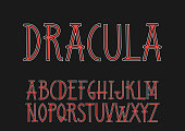 Vector uppercase red and white font 'Dracula' in the Art Nouveau style.