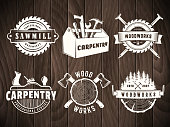 Woodwork badges. Vector icons for carpentry, sawmill, lumberjack service or woodwork shop. Set of labels on vintage wooden background.