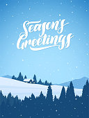 Vector illustration: Vertical Winter snowy mountains christmas landscape with cartoon houses and handwritten lettering of Season's Greetings.