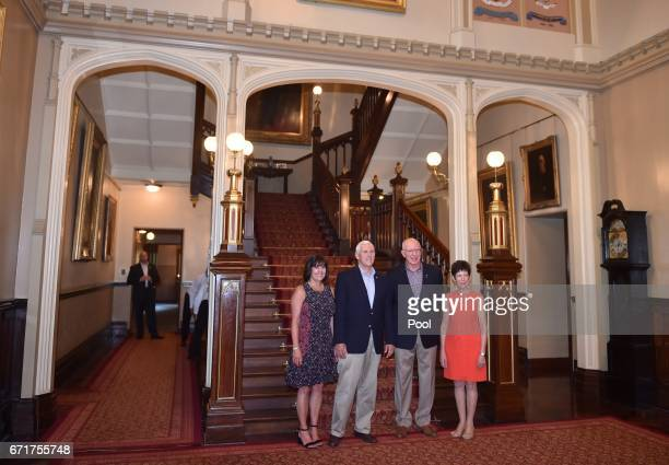 S Vice President Mike Pence his wife Karen pose for a photo at Government House the Governor of New South Wales David Hurley and his wife Linda on...