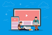 Video on the device concept illustration. Young people using mobile gadgets such as tablet pc and smartphone for viewing video in Internet. Flat big letters chat and guys and women standing near