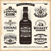 A set of fully editable vintage alcohol labels in woodcut style. EPS10 vector illustration. Includes high resolution JPG.