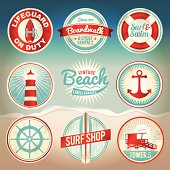 Vintage set of beach labels and badges. EPS 10 with gradient mesh. Gradient mesh is only used in 'distressing' the labels and can be easily removed (layered separately in the file) to support earlier
