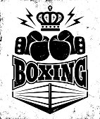 Vector vintage icon for a boxing with two gloves, crown and ring. Emblem for boxing.