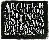 Vintage gothic font in retro style drawing with chalk on chalkboard background