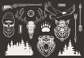Vintage hunting elements collection with bear and boar heads shotgun shell arrows eagle animal footprint gun sight trees silhouette hunter and deer skulls isolated vector illustration