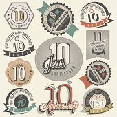 Ten anniversary design in retro style. Vintage labels for anniversary greeting. Hand lettering style typographic and calligraphic symbols for 10 anniversary.