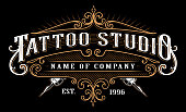 Vintage tattoo studio emblem. Tattoo lettering in retro style frame. Text is on the separate layer. (version for dark background)