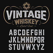 Vintage whiskey label font with sample design. Ideal for any design in vintage style. Vector illustration with transparent effect, eps 10.