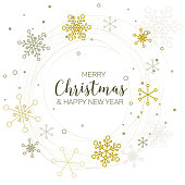 Retro simple Christmas card with circle of golden snowflakes on white background