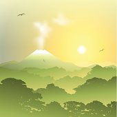 A Misty Forest Landscape with Volcano and Sunset, Sunrise. – vector EPS 10 , gradients and transparencies used.