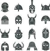 Warrior helmets set of vector icons on white background. Dark silhouettes of helmets of spartans, vikings and samurai. Medieval helmets and protective headgear of knights or soldiers.