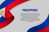 Waving ribbon or banner with flag of Philippines. Template for poster design