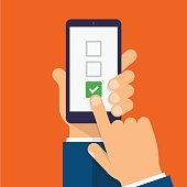 Checkboxes and checkmark on smartphone screen. Hand holds the smartphone and finger touches screen. Checklist modern flat design illustration.