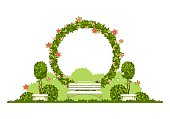 Wedding arch on a white background of plant elements and flowers, park beautiful figures of topiary for a wedding ceremony in the shape of a heart