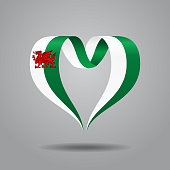 Welsh flag heart-shaped wavy ribbon. Vector illustration.