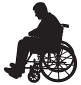 A silhouette of a man in a wheelchair who is depressed by his situation