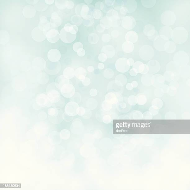 White bokeh on pale green vector background