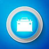 White Car battery icon isolated on blue background. Accumulator battery energy power and electricity accumulator battery. Circle blue button with white line. Vector illustration