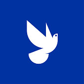 White dove of peace icon on blue background