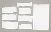 White lined torn note, notebook paper pieces for text stuck on gray background. Vector illustration
