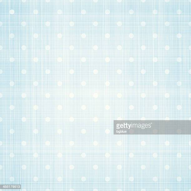 White polka dots on light blue canvas