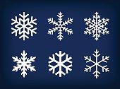 White set of snowflakes on dark blue background.