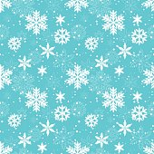 Fluffy white snowflakes on a blue background. Vector seamless pattern. Winter, Christmas mood.