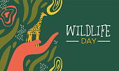 Happy wildlife day illustration. Human hand holding wild giraffe with African safari decoration for animal care and environmental conservation.