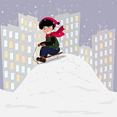 Winter Christmas collection. A boy is riding a toboggan from a hill