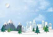 Winter season and urban landscape paper art style background.Nature and environment conservation concept design.Vector illustration.
