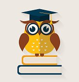 Wise owl with books and graduate cap. Flat design. Vector illustration.