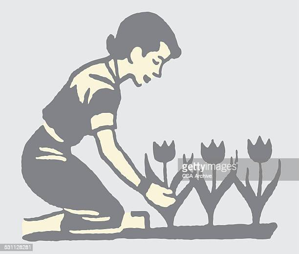 Woman Tending to Her Tulips