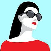 Beautiful elegant woman with long black hair wearing big black sunglasses