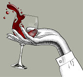Woman's hand holding a glass with red splashed wine. Vintage engraving stylized drawing. Vector illustration