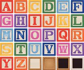 Vector drawing of wooden alphabet blocks.