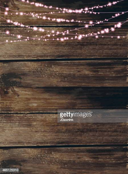 Wooden background with pink string lights