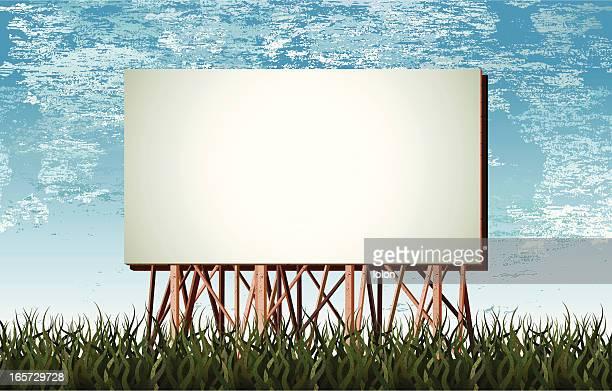 wooden billboard, grunge grass and clouds