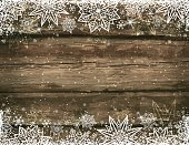 Wooden brown christmas background with snowflakes and stars, vector illustration